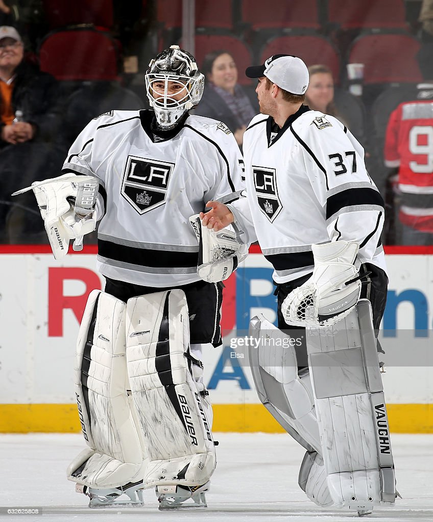 Peter Budaj #31 of the Los Angeles Kings is congratulated by teammate Jeff Zatkoff #37 after the 3-1 win over the New Jersey Devils on January 24, 2017 at Prudential Center in Newark, New Jersey.