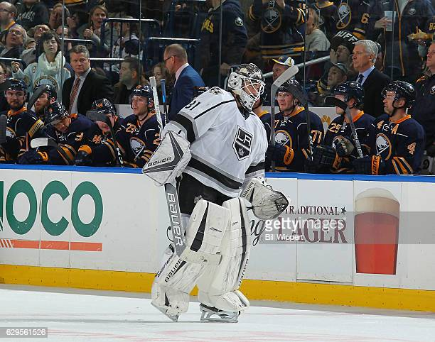 Peter Budaj of the Los Angeles Kings skates to the bench after being pulled in the second period during an NHL game against the Buffalo Sabres at the...