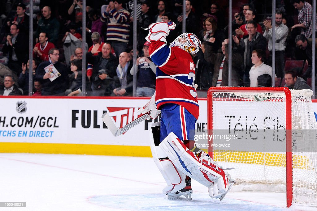 <a gi-track='captionPersonalityLinkClicked' href=/galleries/search?phrase=Peter+Budaj&family=editorial&specificpeople=228123 ng-click='$event.stopPropagation()'>Peter Budaj</a> #30 of the Montreal Canadiens celebrates after defeating the Winnipeg Jets in their NHL game at the Bell Centre on April 4, 2013 in Montreal, Quebec, Canada. The Canadiens defeated the Jets 4-1.