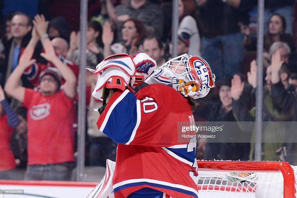 <a gi-track='captionPersonalityLinkClicked' href=/galleries/search?phrase=Peter+Budaj&family=editorial&specificpeople=228123 ng-click='$event.stopPropagation()'>Peter Budaj</a> #30 of the Montreal Canadiens celebrates his shutout victory over the Carolina Hurricanes during the NHL game at the Bell Centre on February 18, 2013 in Montreal, Quebec, Canada. The Canadiens defeated the Hurricanes 3-0.