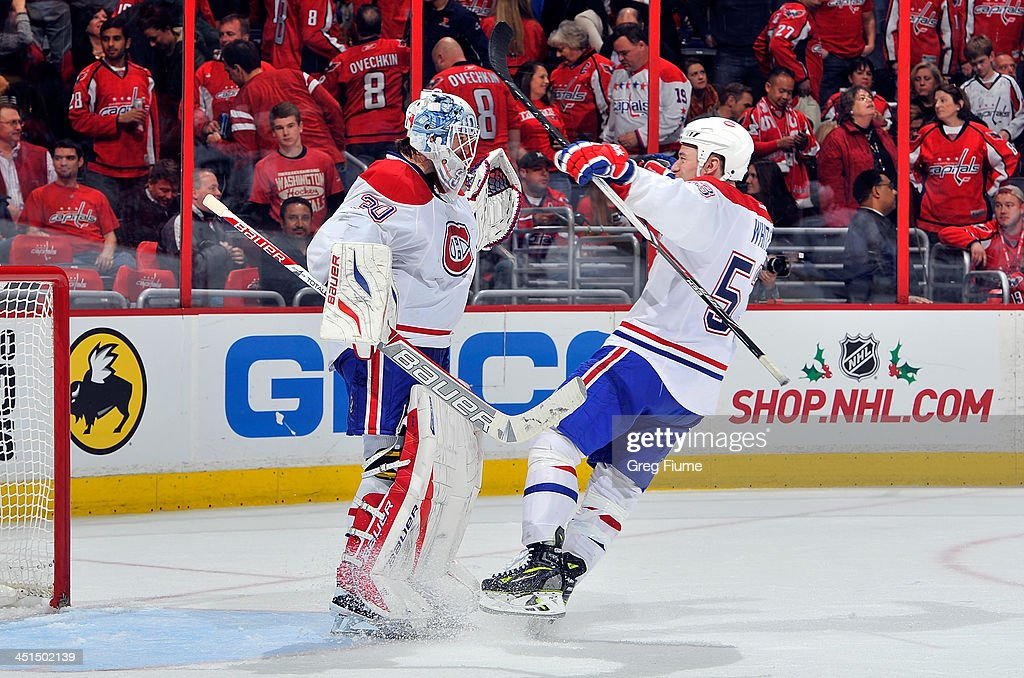 <a gi-track='captionPersonalityLinkClicked' href=/galleries/search?phrase=Peter+Budaj&family=editorial&specificpeople=228123 ng-click='$event.stopPropagation()'>Peter Budaj</a> #30 of the Montreal Canadiens celebrates with teammate <a gi-track='captionPersonalityLinkClicked' href=/galleries/search?phrase=Ryan+White+-+Ice+Hockey+Player&family=editorial&specificpeople=16069622 ng-click='$event.stopPropagation()'>Ryan White</a> #53 after a 3-2 victory against the Washington Capitals at the Verizon Center on November 22, 2013 in Washington, DC.