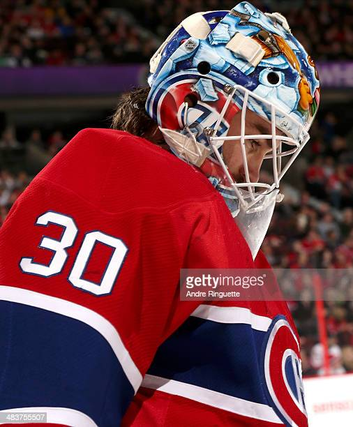 Peter Budaj of the Montreal Canadiens looks on during a stoppage in play against the Ottawa Senators at Canadian Tire Centre on April 4 2014 in...
