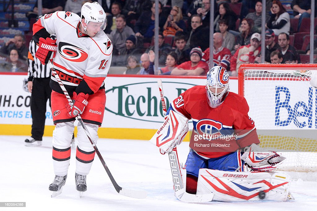 <a gi-track='captionPersonalityLinkClicked' href=/galleries/search?phrase=Peter+Budaj&family=editorial&specificpeople=228123 ng-click='$event.stopPropagation()'>Peter Budaj</a> #30 of the Montreal Canadiens makes a pad save on the puck in front of <a gi-track='captionPersonalityLinkClicked' href=/galleries/search?phrase=Jiri+Tlusty&family=editorial&specificpeople=543236 ng-click='$event.stopPropagation()'>Jiri Tlusty</a> #19 of the Carolina Hurricanes during the NHL game at the Bell Centre on February 18, 2013 in Montreal, Quebec, Canada. The Canadiens defeated the Hurricanes 3-0.