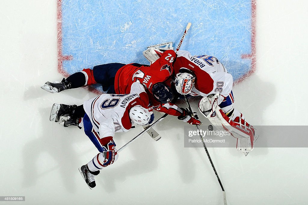 <a gi-track='captionPersonalityLinkClicked' href=/galleries/search?phrase=Peter+Budaj&family=editorial&specificpeople=228123 ng-click='$event.stopPropagation()'>Peter Budaj</a> #30 of the Montreal Canadiens makes a save against Joel Ward #42 of the Washington Capitals in the first period during an NHL game at Verizon Center on November 22, 2013 in Washington, DC.