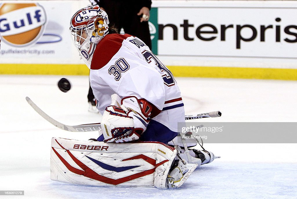 <a gi-track='captionPersonalityLinkClicked' href=/galleries/search?phrase=Peter+Budaj&family=editorial&specificpeople=228123 ng-click='$event.stopPropagation()'>Peter Budaj</a> #30 of the Montreal Canadiens makes a save against the Boston Bruins during a game at the TD Garden on March 3, 2013 in Boston, Massachusetts.