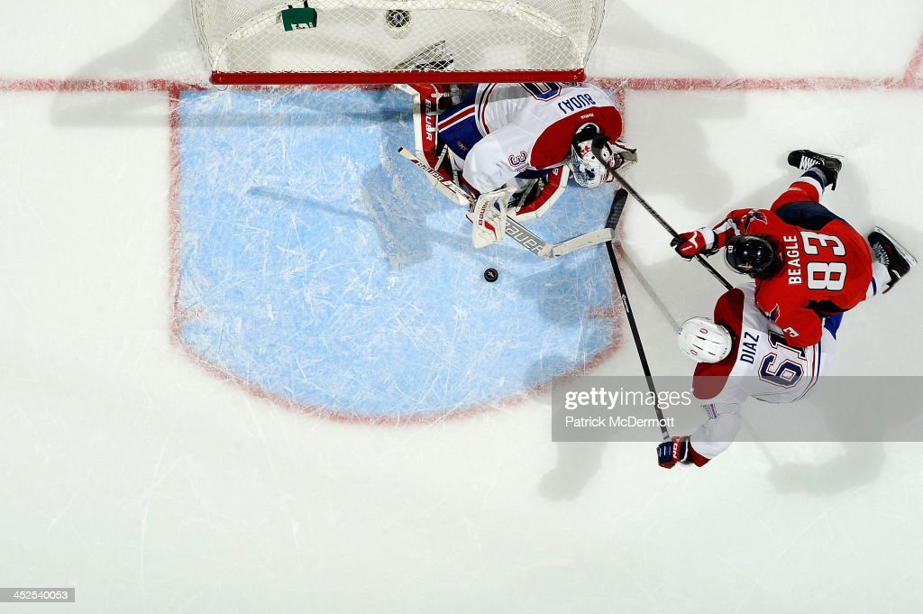 <a gi-track='captionPersonalityLinkClicked' href=/galleries/search?phrase=Peter+Budaj&family=editorial&specificpeople=228123 ng-click='$event.stopPropagation()'>Peter Budaj</a> #30 of the Montreal Canadiens makes a save as <a gi-track='captionPersonalityLinkClicked' href=/galleries/search?phrase=Raphael+Diaz&family=editorial&specificpeople=5333791 ng-click='$event.stopPropagation()'>Raphael Diaz</a> #61 of the Montreal Canadiens and <a gi-track='captionPersonalityLinkClicked' href=/galleries/search?phrase=Jay+Beagle&family=editorial&specificpeople=4671535 ng-click='$event.stopPropagation()'>Jay Beagle</a> #83 of the Washington Capitals battle in front of the net in the third period during an NHL game at Verizon Center on November 29, 2013 in Washington, DC.