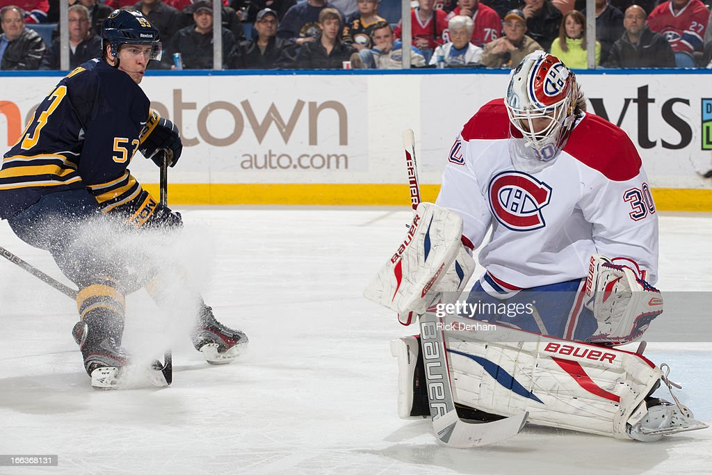 <a gi-track='captionPersonalityLinkClicked' href=/galleries/search?phrase=Peter+Budaj&family=editorial&specificpeople=228123 ng-click='$event.stopPropagation()'>Peter Budaj</a> #30 of the Montreal Canadiens makes a save while <a gi-track='captionPersonalityLinkClicked' href=/galleries/search?phrase=Mark+Pysyk&family=editorial&specificpeople=6571526 ng-click='$event.stopPropagation()'>Mark Pysyk</a> #53 of the Buffalo Sabres looks on during the NHL game at First Niagara Center on April 11, 2013 in Buffalo, New York.