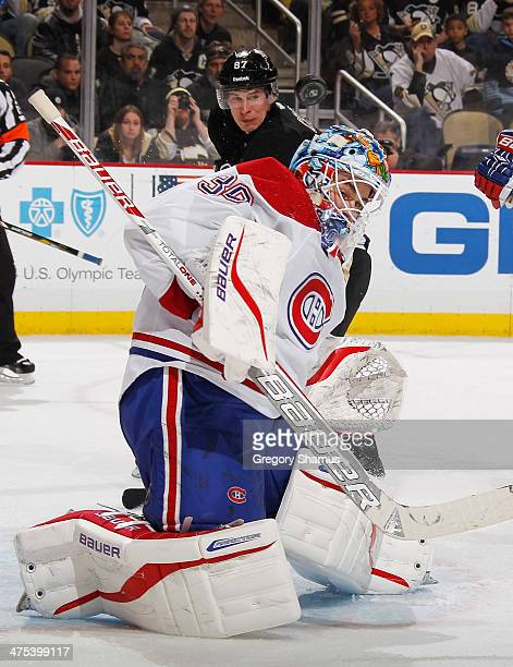 Peter Budaj of the Montreal Canadiens makes a secondperiod save in front of Sidney Crosby of the Pittsburgh Penguins on February 27 2014 at Consol...