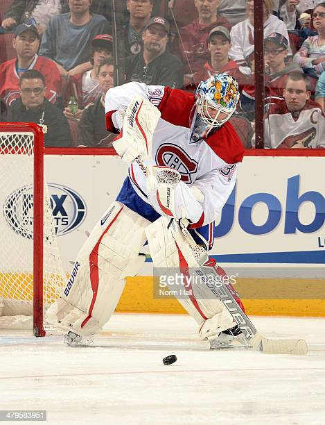 Peter Budaj of the Montreal Canadiens passes the puck up ice against the Phoenix Coyotes at Jobingcom Arena on March 6 2014 in Glendale Arizona