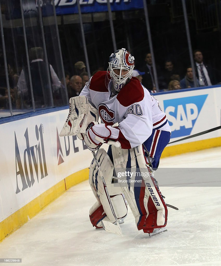 <a gi-track='captionPersonalityLinkClicked' href=/galleries/search?phrase=Peter+Budaj&family=editorial&specificpeople=228123 ng-click='$event.stopPropagation()'>Peter Budaj</a> #30 of the Montreal Canadiens skates against the New York Rangers at Madison Square Garden on October 28, 2013 in New York City. The Canadiens shutout the Rangers 2-0.