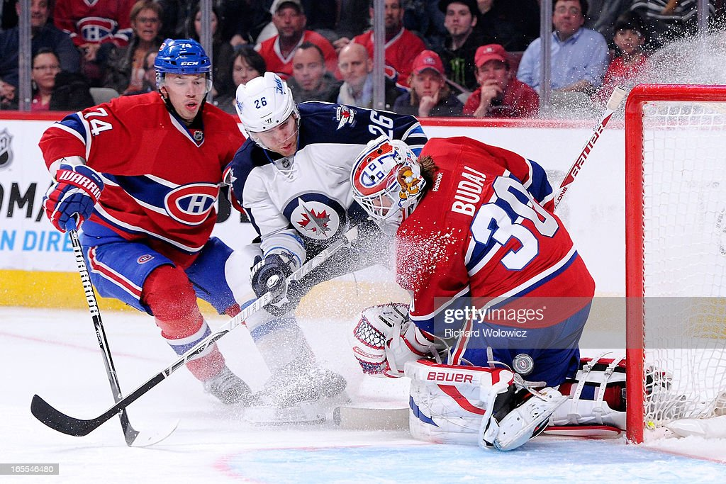 <a gi-track='captionPersonalityLinkClicked' href=/galleries/search?phrase=Peter+Budaj&family=editorial&specificpeople=228123 ng-click='$event.stopPropagation()'>Peter Budaj</a> #30 of the Montreal Canadiens stops the puck on an attempt by <a gi-track='captionPersonalityLinkClicked' href=/galleries/search?phrase=Blake+Wheeler&family=editorial&specificpeople=716703 ng-click='$event.stopPropagation()'>Blake Wheeler</a> #26 of the Winnipeg Jets during the NHL game at the Bell Centre on April 4, 2013 in Montreal, Quebec, Canada. The Canadiens defeated the Jets 4-1.