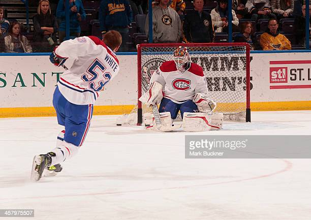 Peter Budaj of the Montreal Canadiens takes warm up shots from Ryan White before an NHL game against the St Louis Blues on December 19 2013 at...