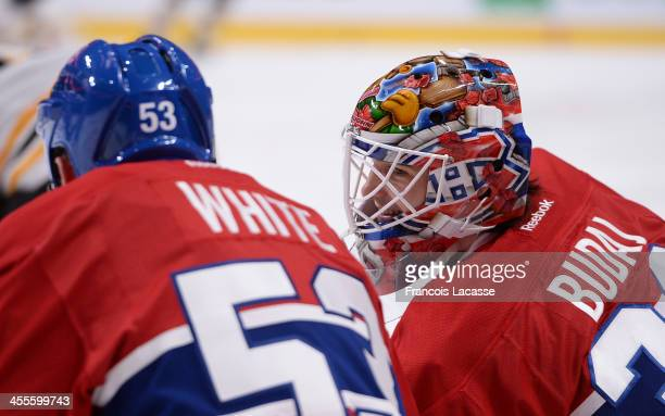 Peter Budaj of the Montreal Canadiens warms up with his new helmet prior to the game against the Boston Bruins during the NHL game on December 5 2013...