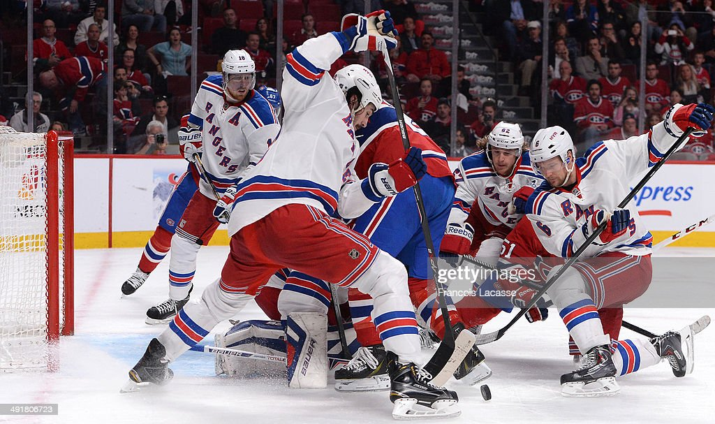 <a gi-track='captionPersonalityLinkClicked' href=/galleries/search?phrase=Peter+Budaj&family=editorial&specificpeople=228123 ng-click='$event.stopPropagation()'>Peter Budaj</a> #30, <a gi-track='captionPersonalityLinkClicked' href=/galleries/search?phrase=Thomas+Vanek&family=editorial&specificpeople=570606 ng-click='$event.stopPropagation()'>Thomas Vanek</a> #20 and <a gi-track='captionPersonalityLinkClicked' href=/galleries/search?phrase=David+Desharnais&family=editorial&specificpeople=4084305 ng-click='$event.stopPropagation()'>David Desharnais</a> #51 of the Montreal Canadiens defend the net against Brian Boyle #22, <a gi-track='captionPersonalityLinkClicked' href=/galleries/search?phrase=Carl+Hagelin&family=editorial&specificpeople=4465394 ng-click='$event.stopPropagation()'>Carl Hagelin</a> #62 and <a gi-track='captionPersonalityLinkClicked' href=/galleries/search?phrase=Anton+Stralman&family=editorial&specificpeople=2271901 ng-click='$event.stopPropagation()'>Anton Stralman</a> #6 of the New York Rangers in Game One of the Eastern Conference Final during the 2014 Stanley Cup Playoffs at the Bell Centre on May 17, 2014 in Montreal, Quebec, Canada.
