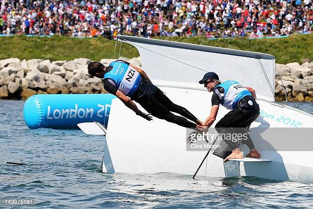 Peter Burling and Blair Tuke of New Zealand celebrate winning silver in the Men's 49er Sailing on Day 12 of the London 2012 Olympic Games at the...
