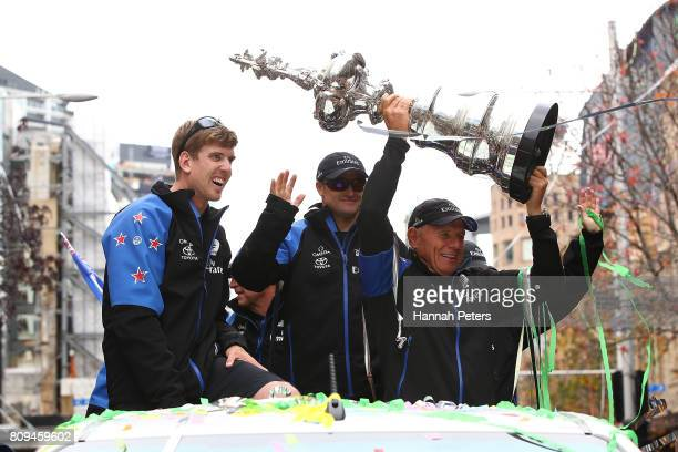 Peter Burling Glenn Ashby and Grant Dalton of Team New Zealand hold up the Americas Cup during the Team New Zealand Americas Cup Welcome Home Parade...