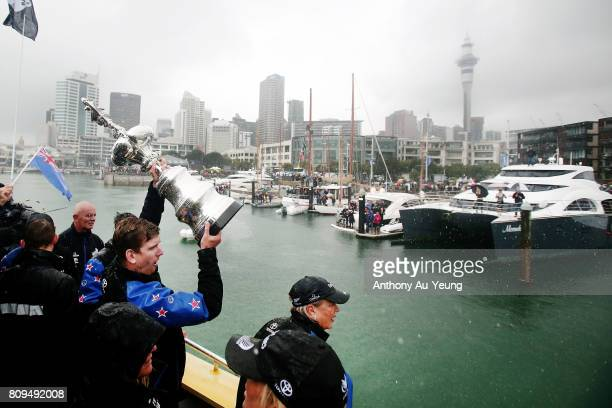 Peter Burling helmsman of Emirates Team New Zealand showcases the America's Cup trophy to the supporters during the Team New Zealand Americas Cup...