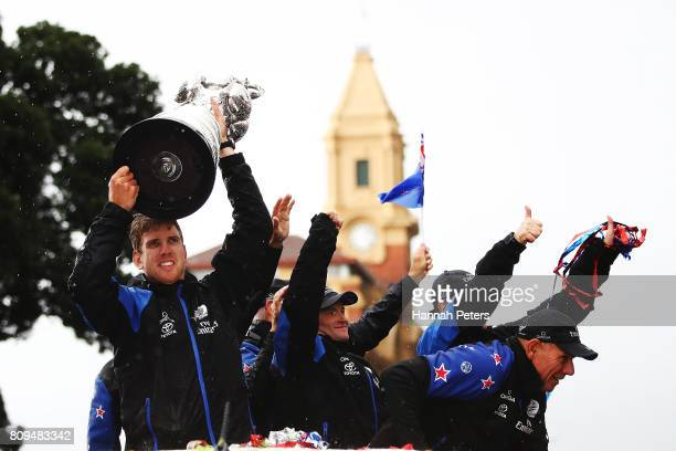 Peter Burling of Team New Zealand holds up the Americas Cup during the Team New Zealand Americas Cup Welcome Home Parade on July 6 2017 in Auckland...
