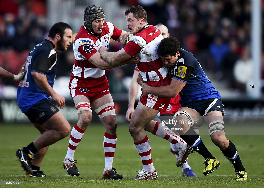 <a gi-track='captionPersonalityLinkClicked' href=/galleries/search?phrase=Peter+Buxton&family=editorial&specificpeople=221205 ng-click='$event.stopPropagation()'>Peter Buxton</a> of Gloucester is tackled by Francis Louw of Bath during the LV= Cup match between Gloucester and Bath at the Kingsholm Stadium on February 2, 2013 in Gloucester, England.