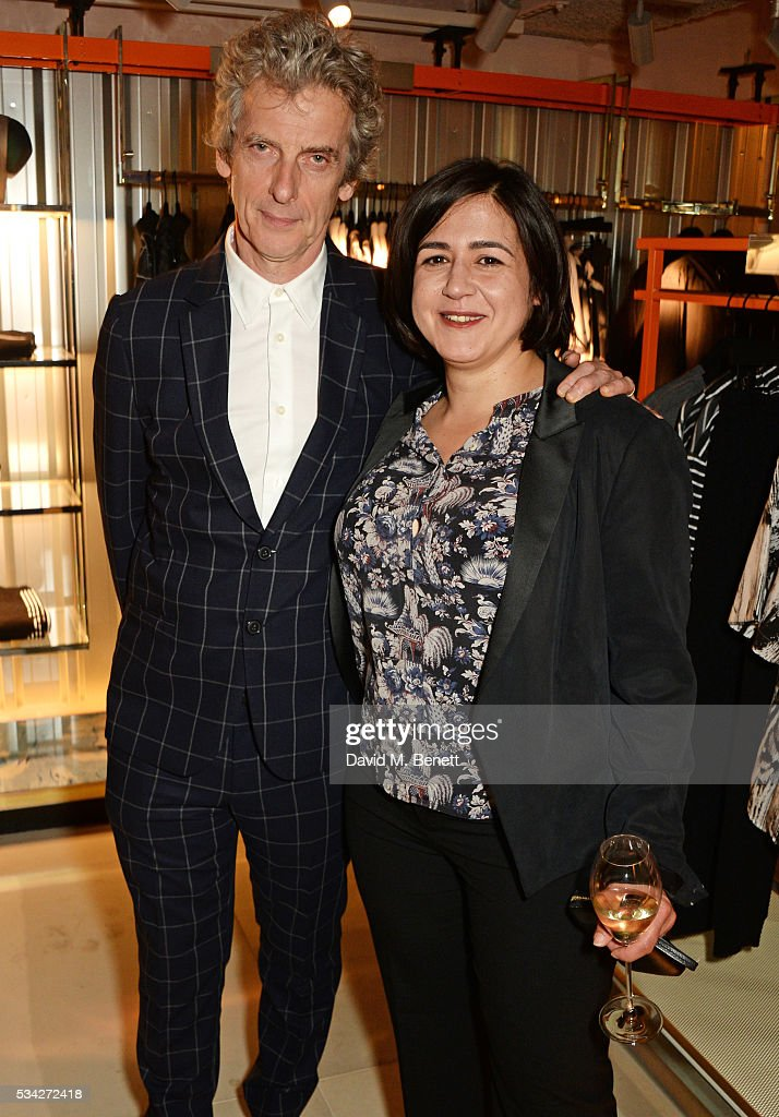 Peter Capaldi (L) and Londoner's Diary editor Joy Lo Dico attend the London Evening Standard Londoner's Diary 100th Birthday Party in partnership with Harvey Nichols at Harvey Nichols on May 25, 2016 in London, England.