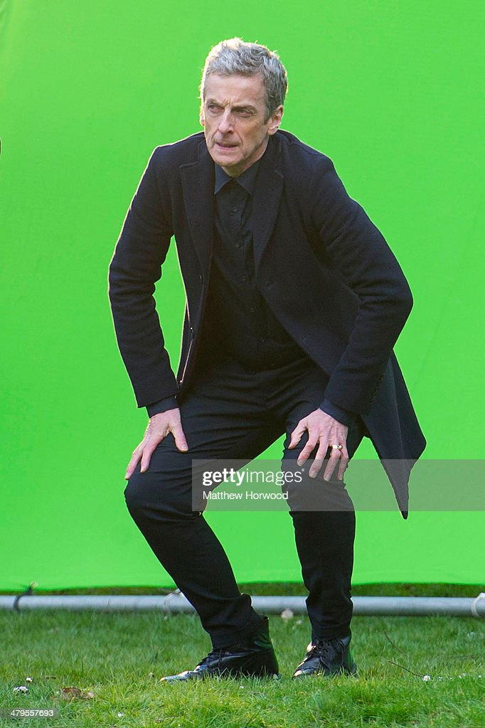 <a gi-track='captionPersonalityLinkClicked' href=/galleries/search?phrase=Peter+Capaldi&family=editorial&specificpeople=639349 ng-click='$event.stopPropagation()'>Peter Capaldi</a> crouches in front of a large green screen during filming for the eighth series of BBC show Doctor Who in Bute Park on March 18, 2014 in Cardiff, Wales.
