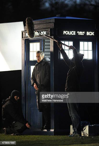 Peter Capaldi spotted walking out of a tardis during filming for the eighth series of BBC show Doctor Who in Bute Park on March 18 2014 in Cardiff...