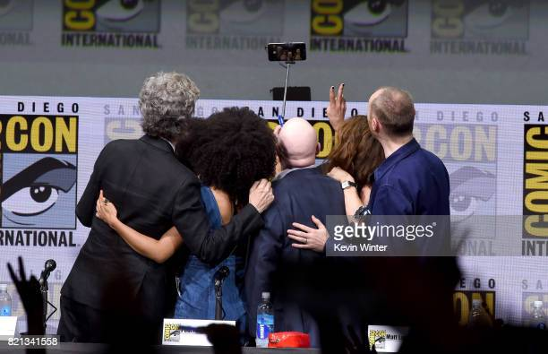 Peter Capaldi Steven Moffat Pearl Mackie Matt Lucas Michelle Gomez and Mark Gatiss take a selfie onstage at 'Doctor Who' BBC America official panel...