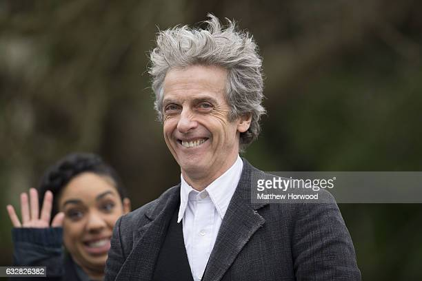 Peter Capaldi who plays the Doctor smiles to the camera while the Doctor's companion Pearl Mackie waves during filming for series 10 of BBC show...