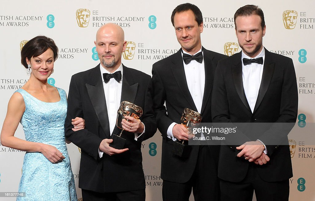 Peter Carlton (2nd from L) and Diarmid Scrimshaw (2nd from R), winners of the Short Film award for 'Swimmer', pose in the press room with presenters Helen McCrory and Rafe Spall at the EE British Academy Film Awards at The Royal Opera House on February 10, 2013 in London, England.