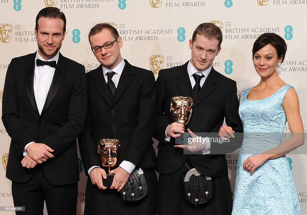 Peter Carlton (2-L) and Diarmid Scrimshaw (2-R), winners of the Short Film award for 'Swimmer', pose in the press room with presenters Helen McCrory and Rafe Spall during the annual BAFTA British Academy Film Awards at the Royal Opera House in London on February 10, 2013. AFP PHOTO/Carl COURT