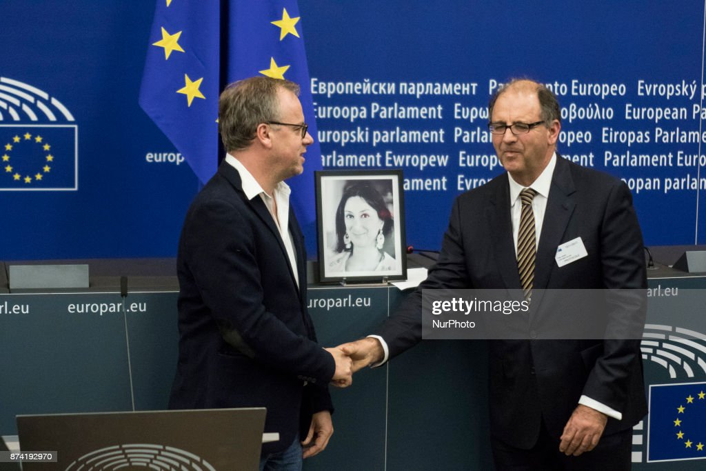 Peter Caruana Galizia, (R) the dead journalist's husband, shakes hands to Secretary General of Reporters without Borders Christophe Deloire (L) during Naming ceremony of press conference room in honour of Daphné CARUANA GALIZIA on 14 november 2017, in Strasbourg, France. Daphné CARUANA GALIZIA was a Maltese journalist, writer, and anti-corruption activist. At around 3 pm on 16 October 2017, Daphne Caruana Galizia died in a car bomb attack on her rented Peugeot 108, while she was driving close to her home in Malta.