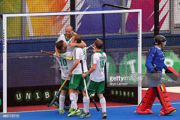 Peter Caruth of Ireland celebrates scoring during the match between Belgium and Ireland on day five of the Unibet EuroHockey Championships at Lee...