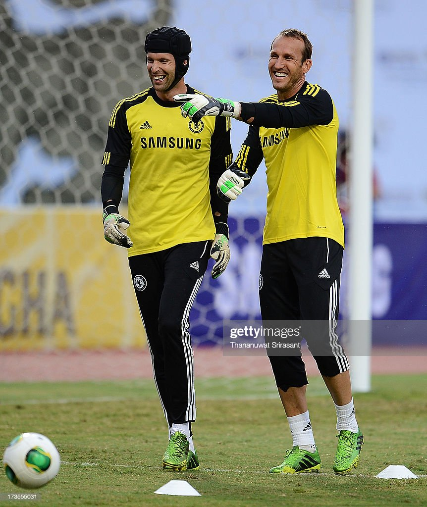 Peter Cech and team-mate <a gi-track='captionPersonalityLinkClicked' href=/galleries/search?phrase=Mark+Schwarzer&family=editorial&specificpeople=208085 ng-click='$event.stopPropagation()'>Mark Schwarzer</a> during a Chelsea FC training session at Rajamangala Stadium on July 16, 2013 in Bangkok, Thailand.