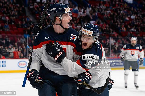 Peter Cehlarik of Team Slovakia is joined by teammate Robert Lantosi to celebrate his goal in a quarterfinal round during the 2015 IIHF World Junior...