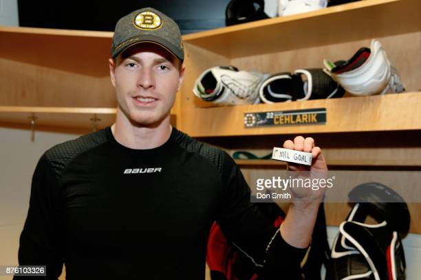 Peter Cehlarik of the Boston Bruins holds up the puck from his first NHL goal during a game against the San Jose Sharks at SAP Center on November 18...