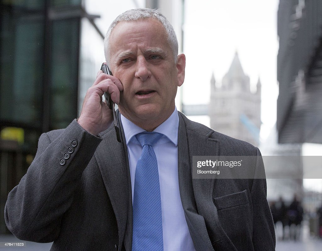 Peter Charles Johnson, a former Barclays Plc Libor trader, speaks on his mobile phone as he leaves Southwark Crown Court after facing charges in connection with the manipulation of the London interbank offered rate, or Libor, in London, U.K., on Monday, March 3, 2014. Prosecutors and regulators around the world are investigating whether more than a dozen firms colluded to rig the interest rate benchmark and have issued fines of about $6 billion against financial institutions. Photographer: Jason Alden/Bloomberg via Getty Images