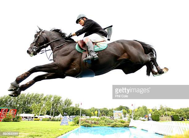 Peter Charles riding Murkas Pall Mall H clears the water jump and goes on to win Longines King George V Gold Cup at the Longines International Horse...