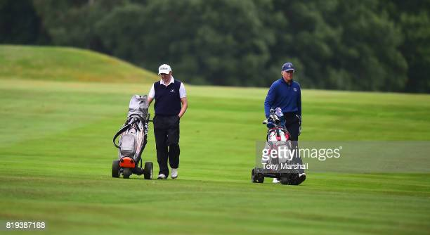 Peter Cherry and Frank Ward of Ashridge Golf Club walk down the 17th fairway during the PGA Lombard Trophy East Qualifier at Sandy Lodge Golf Club on...