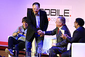 Peter Chou chief executive officer of HTC and Stephen Elopchief executive officer of Nokia are shaking hands during a keynote event at the Mobile...