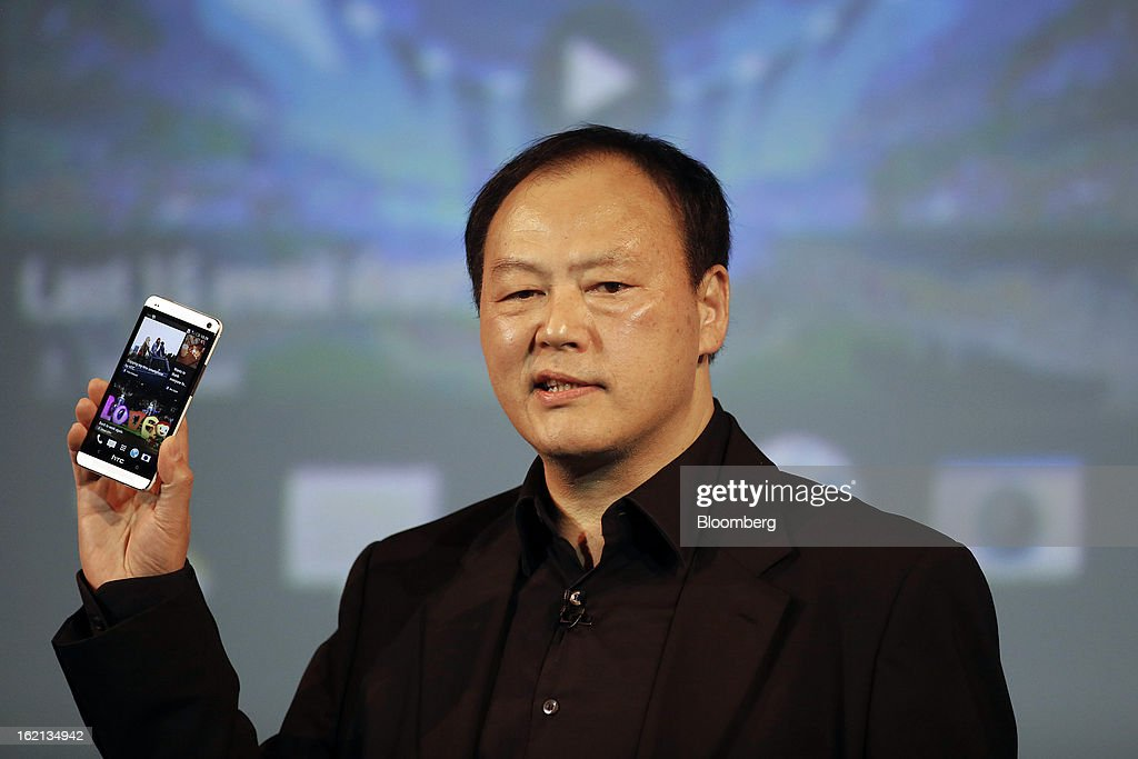 Peter Chou, chief executive officer of HTC Corp., holds a new HTC One smartphone during a launch event in London, U.K., on Tuesday, Feb. 19, 2013. HTC Corp. introduced its new flagship HTC One smartphone at a launch event in London today. Photographer: Simon Dawson/Bloomberg via Getty Images