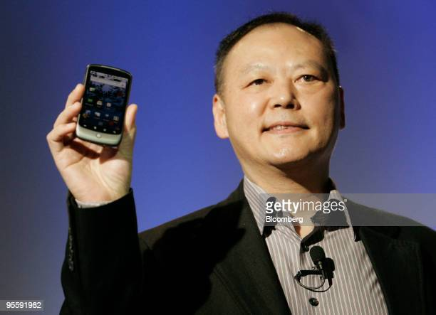 Peter Chou chief executive officer of HTC Corp holds the Google Nexus One touchscreen mobile phone during a news conference at Google headquarters in...