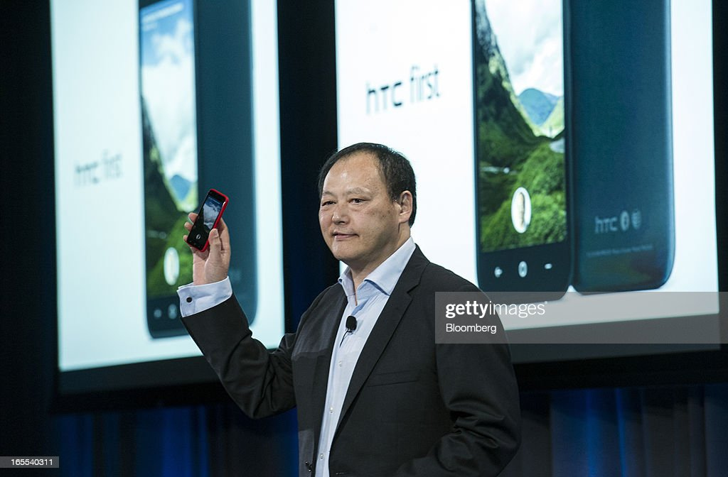 Peter Chou, chief executive officer of HTC Corp., holds up a new HTC First phone as he speaks during an event at Facebook Inc. headquarters in Menlo Park, California on Thursday, April 4, 2013. Facebook unveiled smartphone software called Home that puts social-networking features front and center on a handset, stepping up efforts to boost sales of advertising on small screens. Photographer: David Paul Morris/Bloomberg via Getty Images News