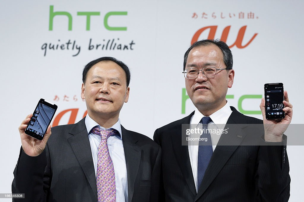 Peter Chou, chief executive officer of HTC Corp., left, stands with Takashi Tanaka, president of KDDI Corp., as they hold the HTC J Butterfly smartphone during the unveiling event in Tokyo, Japan, on Tuesday, Nov. 20, 2012. Taiwan's HTC Corp. needs to improve its global brand awareness to gain share in China, and its newly unveiled model is likely to help the vendor do that. Photographer: Kiyoshi Ota/Bloomberg via Getty Images