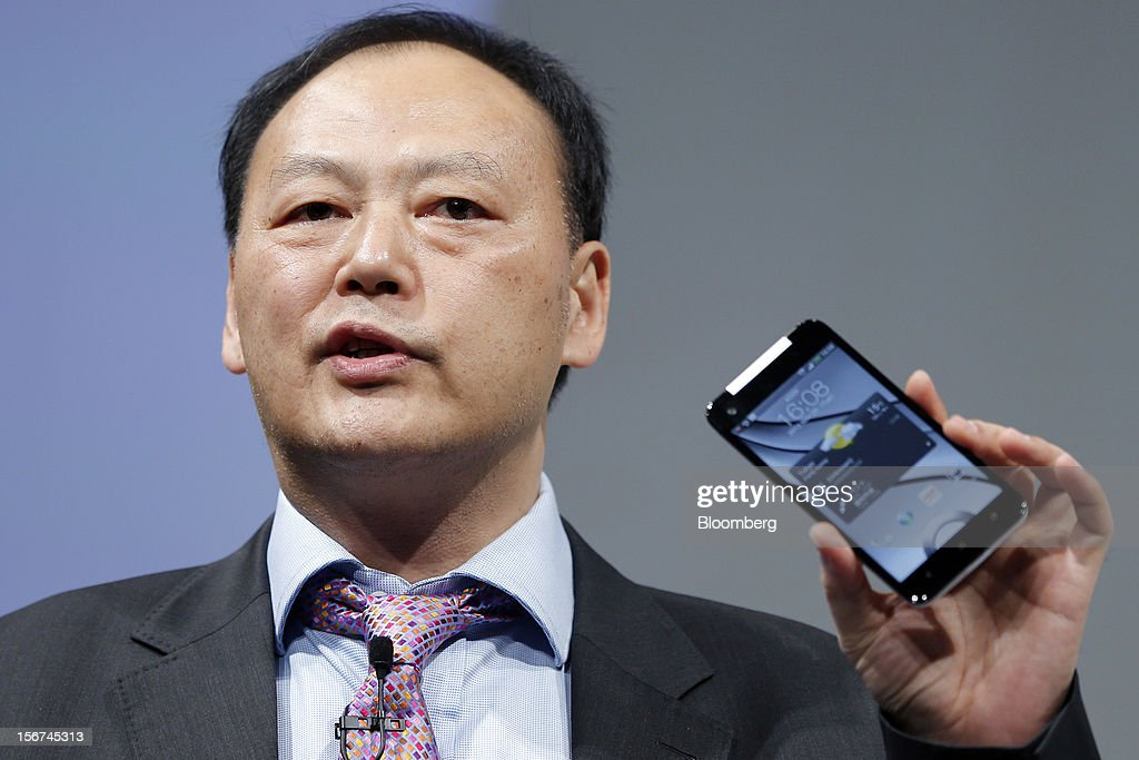 Peter Chou, chief executive officer of HTC Corp., speaks as he holds a HTC J Butterfly smartphone during the unveiling event in Tokyo, Japan, on Tuesday, Nov. 20, 2012. Taiwan's HTC Corp. needs to improve its global brand awareness to gain share in China, and its newly unveiled model is likely to help the vendor do that. Photographer: Kiyoshi Ota/Bloomberg via Getty Images