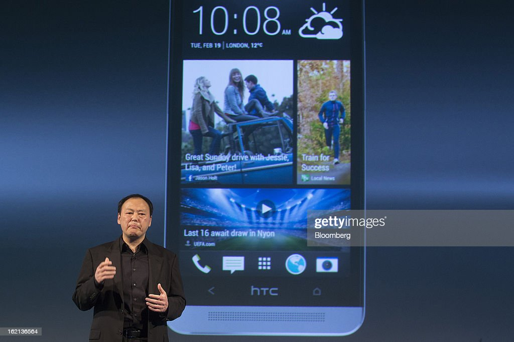 Peter Chou, chief executive officer of HTC Corp., speaks while standing beneath a projection of the new HTC One smartphone during a launch event in London, U.K., on Tuesday, Feb. 19, 2013. HTC Corp. introduced its new flagship HTC One smartphone at a launch event in London today. Photographer: Simon Dawson/Bloomberg via Getty Images