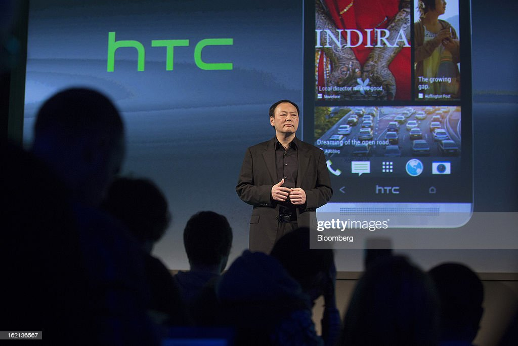 Peter Chou, chief executive officer of HTC Corp., stands beneath a projection of the new HTC One smartphone during a launch event in London, U.K., on Tuesday, Feb. 19, 2013. HTC Corp. introduced its new flagship HTC One smartphone at a launch event in London today. Photographer: Simon Dawson/Bloomberg via Getty Images