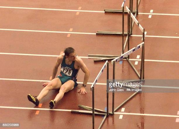Peter Coghlan of Ireland sits on the track after falling in the 110m Hurdles race at the CGU Gateshead Classic Athletics Meeting The race was won by...