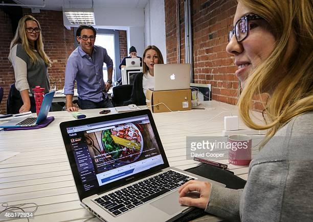 Peter Coreell consults with members of the team at Hubub a new social platform startup that Bell Media has invested $5 million in