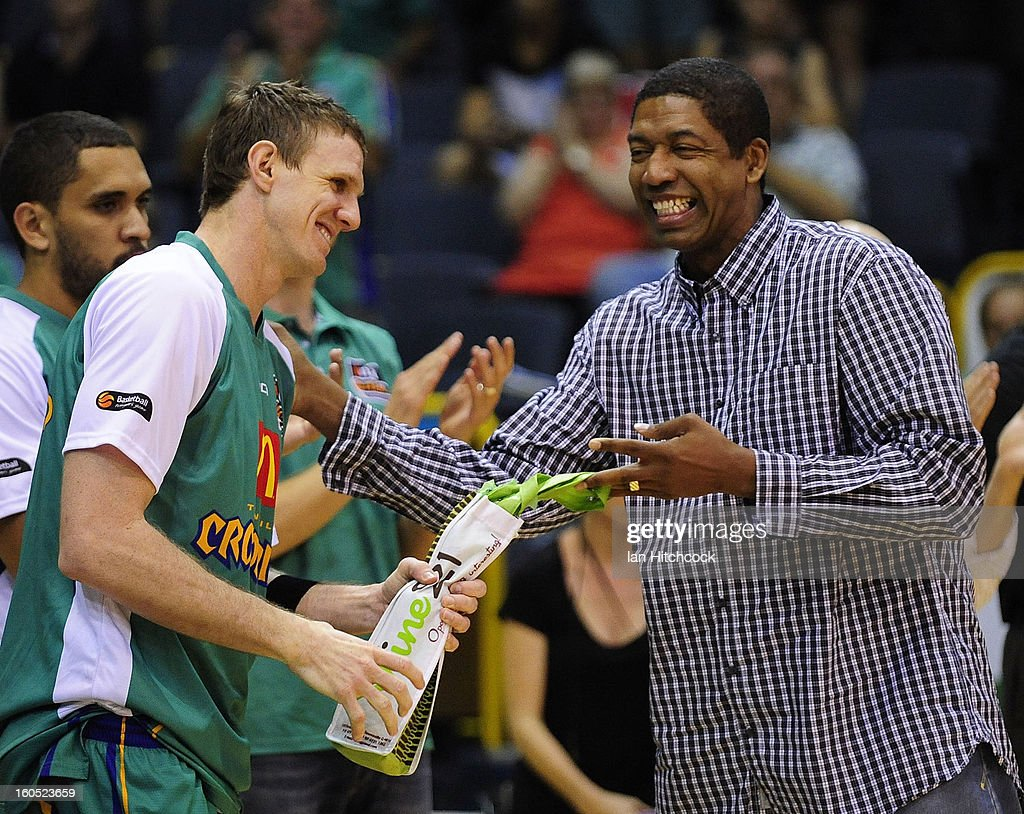 Peter Crawford of the Crocodiles is presented with a bottle of wine by Rob Rose as he becomes the most capped player in the clubs history before the start of the round 17 NBL match between the Townsville Crodcodiles and the Sydney Kings at Townsville Entertainment Centre on February 2, 2013 in Townsville, Australia.