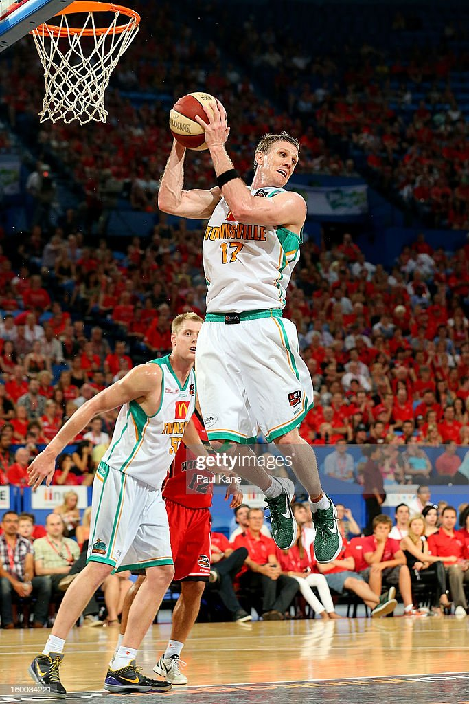 Peter Crawford of the Crocodiles rebounds during the round 16 NBL match between the Perth Wildcats and the Townsville Crocodiles at Perth Arena on January 25, 2013 in Perth, Australia.